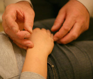 A patient receieving Acupuncture on their arm