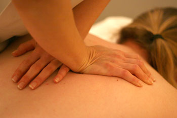 An osteopath works on a back