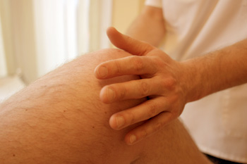 An osteopath manipulating a knee