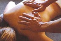 A patient receiving a massage