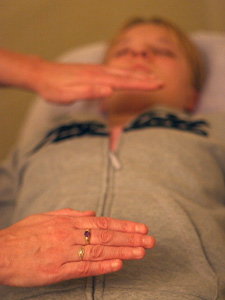 A patient recieves Reiki