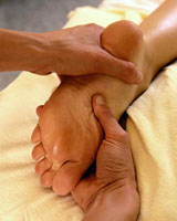 A patient getting a reflexology massage